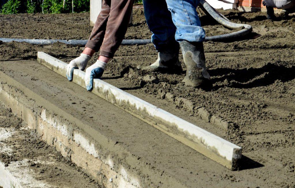 professional concrete specialist working on concrete repair