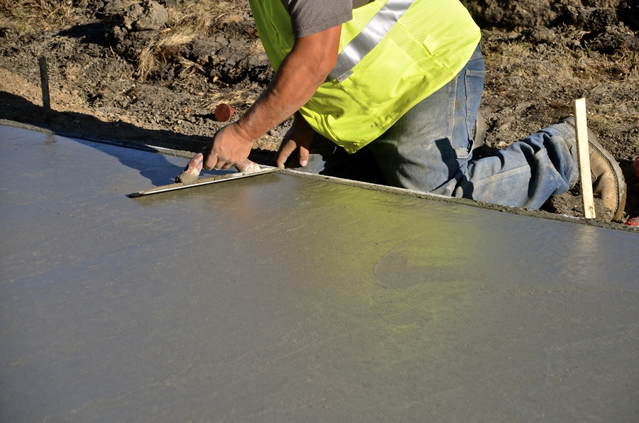 professional concrete specialist working on concrete repair