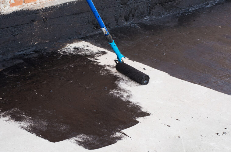 professional concrete specialist working on concrete sealing