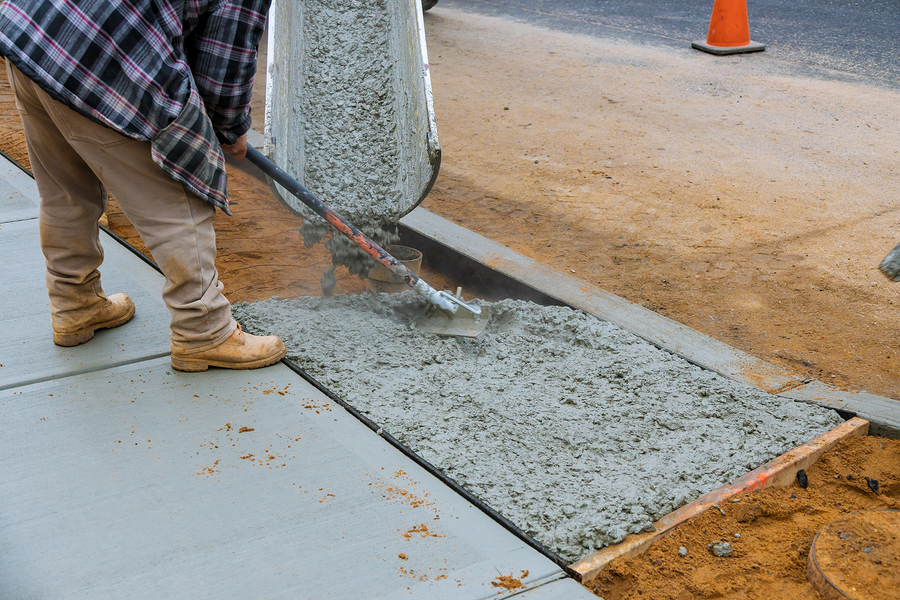 professional concrete specialist working on concrete stamping